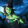 Witch with on Halloween night - Stockfoto