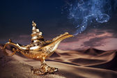 Magic Aladdin's Genie lamp on a desert — Stockfoto