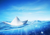 Paper boat at sea on a shiny day — Stock Photo