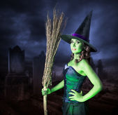 Halloween witch with her broomstick — Stock Photo