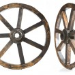Old vintage wood wheel on white — Stock Photo