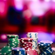 Casino chips on gaming table — Stock Photo