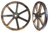 Old vintage wood wheel on white — Stock Photo
