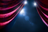 Theater curtain with dramatic lighting — Stock Photo