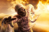 Scary mummy in a desert at sunset — Stock Photo