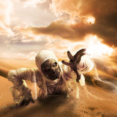 Scary mummy in a desert — Stock Photo