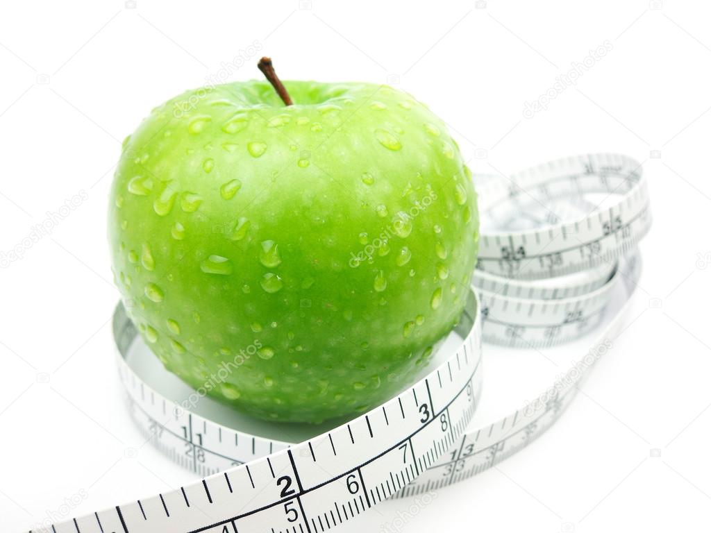 Green Apple with measuring tape on white background — Stock Photo #12628635