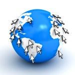 Many arrow cursors around blue globe map — Stock Photo