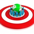Group of holding hands in circle around green globe on red target — Stock Photo
