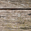 Stock Photo: Texture of Old Weathered and Discolored Wooden Boards