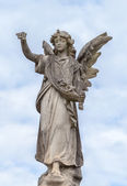 Stone Angel Statue against Clouds and Blue Sky — Stock Photo