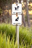 Very Faded Sign in Nature Reserve: No Dogs, No Cats — Stock Photo
