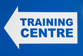 Sign with Arrow Pointing Left Stating TRAINING CENTRE — Stock Photo