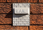Metal Mailbox Inset into Red Textured Brick Wall — Stock Photo