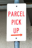Dirty Sign Stating PARCEL PICK UP with Right Arrow — Zdjęcie stockowe