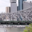 Stock Video: Medium wide shot of traffic grossing Story Bridge in Brisbane Australia
