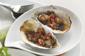 Oysters Kilpatrick — Stock Photo