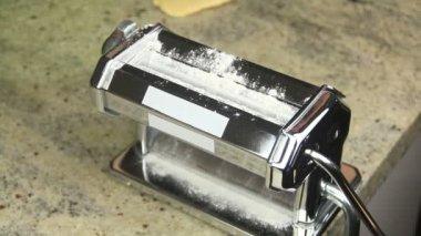 Putting flour into pasta maker — Stock Video