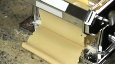 Dough sheets coming out of pasta machine — Stock Video