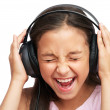 The girl is  listening to loudly music — Stock Photo