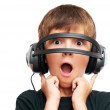 Stock Photo: Surprised boy looking through headphones and screams