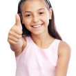 Pretty little girl showing thumbs up — Stock Photo