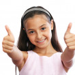 Pretty little girl showing thumbs up — Stock Photo #12714187