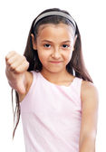 Pretty little girl showing thumbs down — Stock Photo