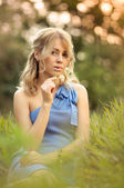 Girl sitting in the grass — Stock Photo