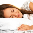 Stock Photo: Beautiful girl sleeps in bedroom