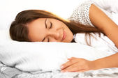 Beautiful girl sleeps in the bedroom — Stock Photo