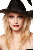 Beautiful blonde in a witches hat — Stock Photo