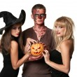 Vampire, zombie and witch holding a pumpkin — Stock Photo #13499929