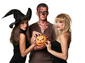 Vampire, zombie and witch holding a pumpkin — Stock Photo