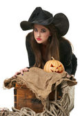 Witch in a hat sitting near the chest — Stock Photo