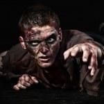 The zombie is lying in the studio — Stock Photo