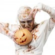 Evil mummy is holding pumpkin — Stock Photo #13851476