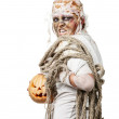Foto Stock: The mummy is holding the pumpkin