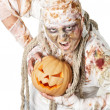 Evil mummy is holding pumpkin — Stock Photo