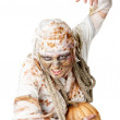 Evil mummy is holding pumpkin — Stock Photo #13851491