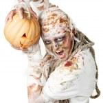 Evil mummy is holding pumpkin — Stock Photo