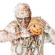 Evil mummy is holding pumpkin — Stock Photo #13851494