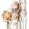 Evil mummy is holding pumpkin — Stock Photo #13851497