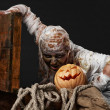 Mummy in the studio with pumpkin and rope — Stock Photo
