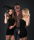 Zombie vampire and witch in the dark studio — Stock Photo