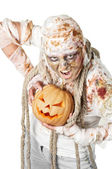 Evil mummy is holding pumpkin — Стоковое фото