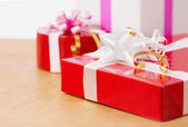 Beautiful gifts in the table — Stock Photo