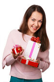 The smiling girl with the presents in the studio — Stock Photo