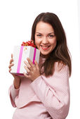 The smiling girl take present — Stock Photo