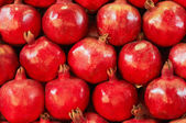 Healthy food. Many red pomegranate — Stock Photo